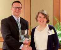 Jared Parko receiving Mather Award from Dr. Wilkins