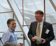 Frank Yiannas receiving award from Dept. Chair Dr. Dan Grooms