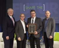 (L to R) Michael Dykes, IDFA president and CEO; Mike Wells, president and CEO, Wells Enterprises; Brian Kraus, director of food safety and regulatory compliance, Wells Enterprises; and John Allan, IDFA vice president.